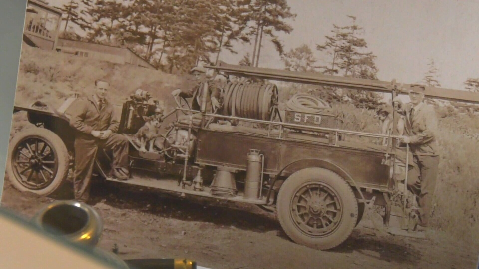 Saanich firefighters pose by the first fire truck purchased by the District in 1919. (Saanich Archives)