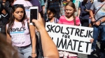 Swedish environmental activist Greta Thunberg, right, takes part during the Climate Strike, Friday, Sept. 20, 2019 in New York. (AP Photo/Eduardo Munoz Alvarez)