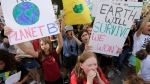 Students chant as they gather for a climate strike rally at the Texas capitol, Friday, Sept. 20, 2019, in Austin, Texas. A wave of climate change protests swept across the globe Friday, with hundreds of thousands of young people sending a message to leaders headed for a U.N. summit. (AP Photo/Eric Gay)