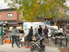 Calgarians were asked to contribute to a large painting of Kensington as part of PARK(ing) Day.
