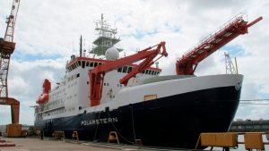 In this Wednesday, July 3, 2019 file photo the German Arctic research vessel 'Polarstern' is docked for maintenance in Bremerhaven, Germany. About 100 researchers will set sail Friday from Tromso, Norway, aboard the German icebreaker 'Polarstern' in an effort to understand how climate change is affecting the Arctic and regions beyond. (AP Photos/Frank Jordans, file)