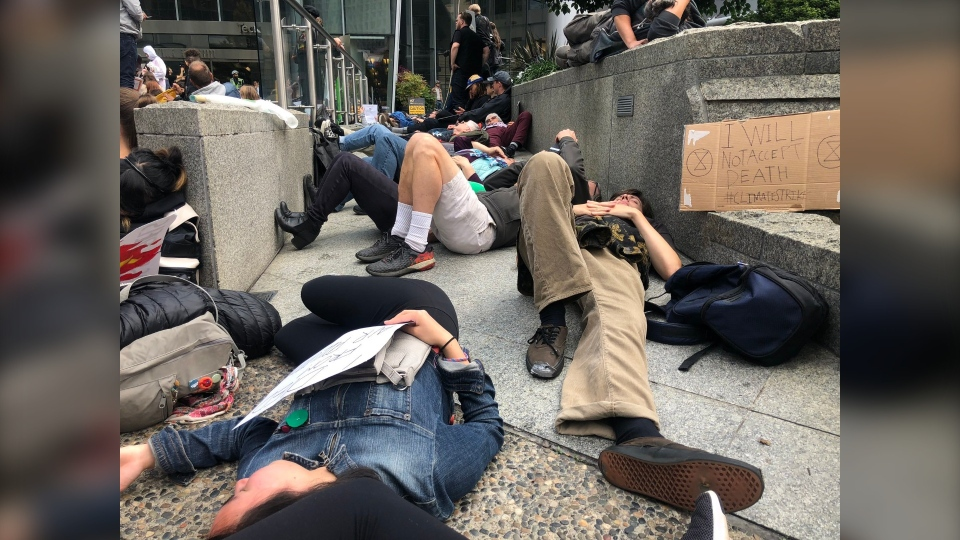 """Young protesters staged a """"die-in"""" in Vancouver to take a stand against climate change."""