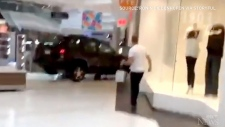 Caught on cam: Car plows through Chicago mall