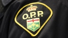File photo of OPP badge. (THE CANADIAN PRESS/Nathan Denette)