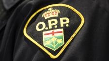 File photo of OPP badge. (THE CANADIAN PRESS/Nathan Denette)