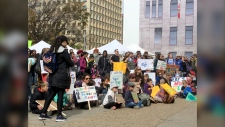 Hundreds of Calgarians rallied outside city hall on Friday, calling for governments do more to prevent climate change.