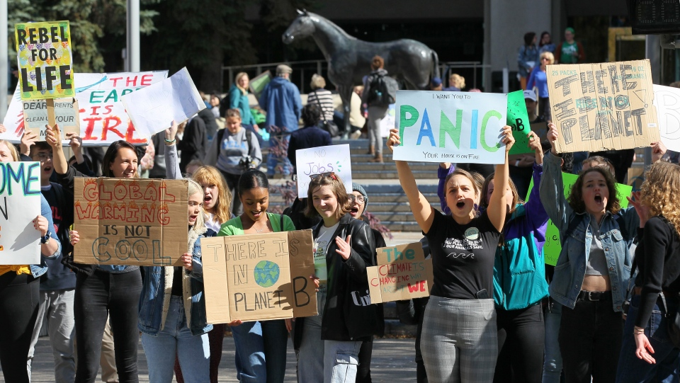 Climate change activists and students gather for a protest and
