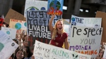 Students concerned about climate change take part in a climate-strike rally at City Hall Plaza Friday, Sept. 20, 2019 at City Hall Plaza in Boston. (Matt Stone / The Boston Herald via AP)