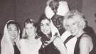 A photo showing Liberal Leader Justin Trudeau, second right, then 29-years-old, wearing dark paint on his hands and face while dressed as Aladdin at a themed gala event, is seen in a 2000-01 yearbook from West Point Grey Academy where he was a teacher, in Vancouver, on Friday September 20, 2019. THE CANADIAN PRESS/Darryl Dyck