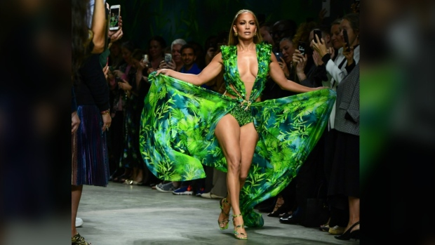 The actress closed the show in a green silk creation with its deep-V plunging neckline, triggering an ecstatic reaction from the audience. (AFP)