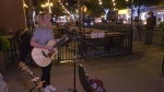 Julia Vos busking on Whyte Avenue to raise funds for YESS. Sept. 21, 2019. (CTV News Edmonton)