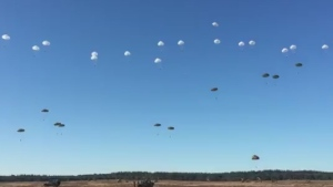 Parachutes glowing gold and white against clear blue skies, hundreds of paratroopers floated to the ground in the eastern Netherlands on Saturday to mark the 75th anniversary of a daring but ultimately unsuccessful mission that Allied commanders hoped would bring a swift end to World War II. (16 Air Assault Brigade/Twitter)