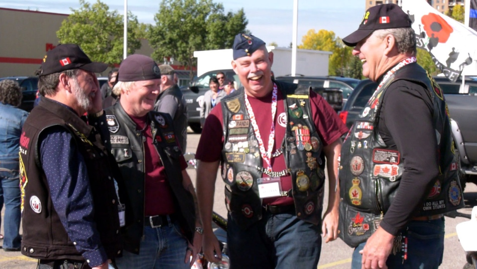 Todd Gilman (second from left) now volunteers with Veteran's Association Food Bank, the organization he credits with saving his life.