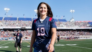U.S. Open tennis champion Bianca Andreescu walks off the field prior to a CFL football game between the Montreal Alouettes and the Winnipeg Blue Bombers, in Montreal, Saturday, Sept. 21, 2019. THE CANADIAN PRESS/Graham Hughes