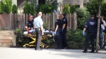 Video from the scene showed paramedics carrying a small patient onto a gurney. (CTV)
