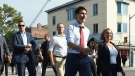 Liberal Leader Justin Trudeau crosses a street as he makes his way to make a policy announcement in Toronto on Friday, Sept. 20, 2019. THE CANADIAN PRESS/Sean Kilpatrick