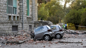 Damaged cars outside the Faculty of Geology building after an earthquake in Tirana, Saturday, Sept. 21, 2019. (AP Photo/Hektor Pustina)