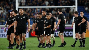 New Zealand's All Blacks leave the field after winning the Rugby World Cup Pool B game over South Africa in Yokohama, Japan, Saturday, Sept. 21, 2019. (AP Photo/Shuji Kajiyama)