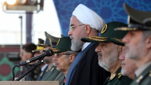 In this photo released by the official website of the office of the Iranian Presidency, President Hassan Rouhani reviews a military parade marking 39th anniversary of outset of Iran-Iraq war, in front of the shrine of the late revolutionary founder Ayatollah Khomeini, just outside Tehran, Iran, Sunday, Sept. 22, 2019. (Iranian Presidency Office via AP)