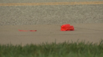 An orange wrist band can be seen on the ground in Pittsburgh, Pa. (WPXI)