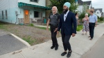 NDP Leader Jagmeet Singh, joined by area residents, tours a neighbourhood damaged by recent flooding during a campaign stop in Gatineau, Que. on Sunday, Sept. 22. 2019. THE CANADIAN PRESS/Andrew Vaughan