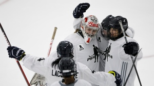 Team Johnston goaltender Marlene Johnston (1) celebrates with teammates Kacey Bellamy (22), Meaghan Mikkelson (12) , Brigette Lacquette (4) and Katelyn Gosling (45) a victory over Team Knox in a shootout at the Unifor Women's Hockey Showcase in Toronto, Sunday, Sept. 22, 2019. THE CANADIAN PRESS/Cole Burston