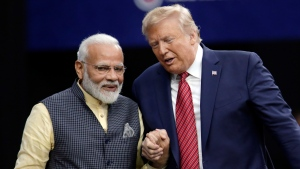 "President Donald Trump shakes hands with Indian Prime Minister Narendra Modi during the ""Howdy Modi: Shared Dreams, Bright Futures"" event at NRG Stadium, Sunday, Sept. 22, 2019, in Houston. (AP Photo/Michael Wyke)"