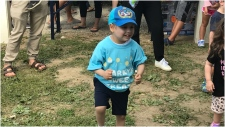 Five-year-old Marky Czutrin dances at a fundraiser for SickKids Hospital in his honour. (CTV News Toronto/Nick Dixon)