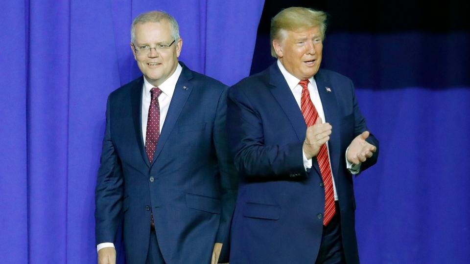President Donald Trump, right, and Australian Prime Minister Scott Morrison take the stage as they mark the opening of an Australian-owned Pratt Industries plant, Sunday, Sept. 22, 2019, in Wapakoneta, Ohio. (AP Photo/John Minchillo)