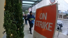 Workers picketed outside Hotel Georgia in downtown Vancouver Sunday, after officially walking off the job overnight. (CTV)