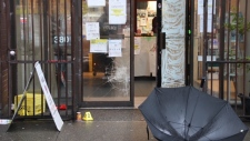 Images from the scene showed broken glass in the window of a building on Hastings Street. (CTV)