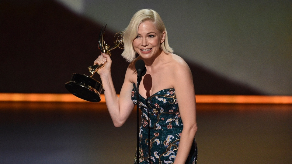 """Michelle Williams accepts the award for outstanding lead actress in a limited series or movie for """"Fosse/Verdon"""" at the 71st Primetime Emmy Awards on Sunday, Sept. 22, 2019, at the Microsoft Theater in Los Angeles. (Photo by Chris Pizzello/Invision/AP)"""