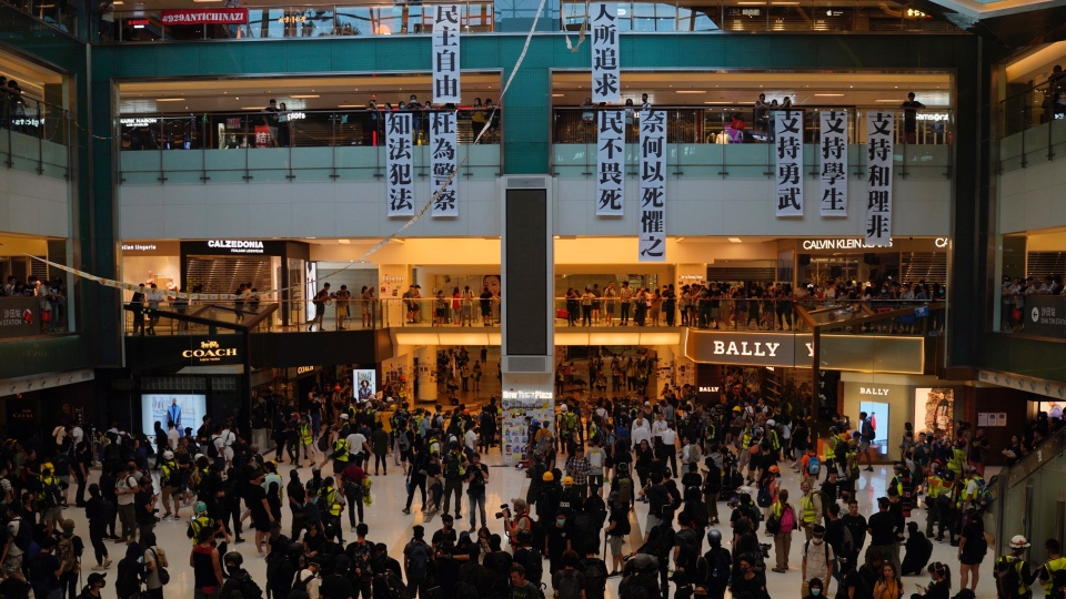 Banners calling for democracy and support for protesters are hung at a mall in Hong Kong on Sunday, Sept. 22, 2019. (AP Photo/Vincent Yu)