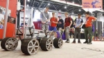 Students check out a robotic rover at the Canada-Wide Science Fair at Carleton University, in Ottawa on Wednesday, May 16, 2018. THE CANADIAN PRESS/ Patrick Doyle