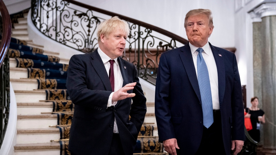 FILE - In this Aug. 25, 2019, file photo, President Donald Trump and Britain's Prime Minister Boris Johnson, left, speak to the media before a working breakfast meeting at the Hotel du Palais on the sidelines of the G7 summit in Biarritz, France. (Erin Schaff/The New York Times, Pool, File)