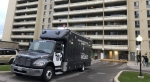 A Forensic Identification Services vehicle is shown at the scene of a homicide investigation at an apartment building in Scarborough on Monday morning. (Carol Charles / CTV News Toronto)