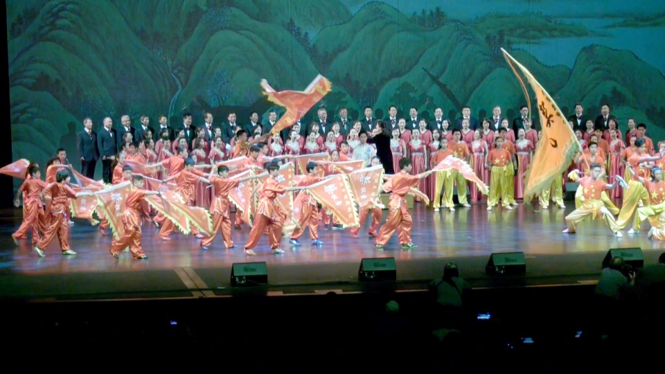 Dancers perform during a celebration for the 70th anniversary of the founding of the People's Republic of China at the Jubilee Auditorium.