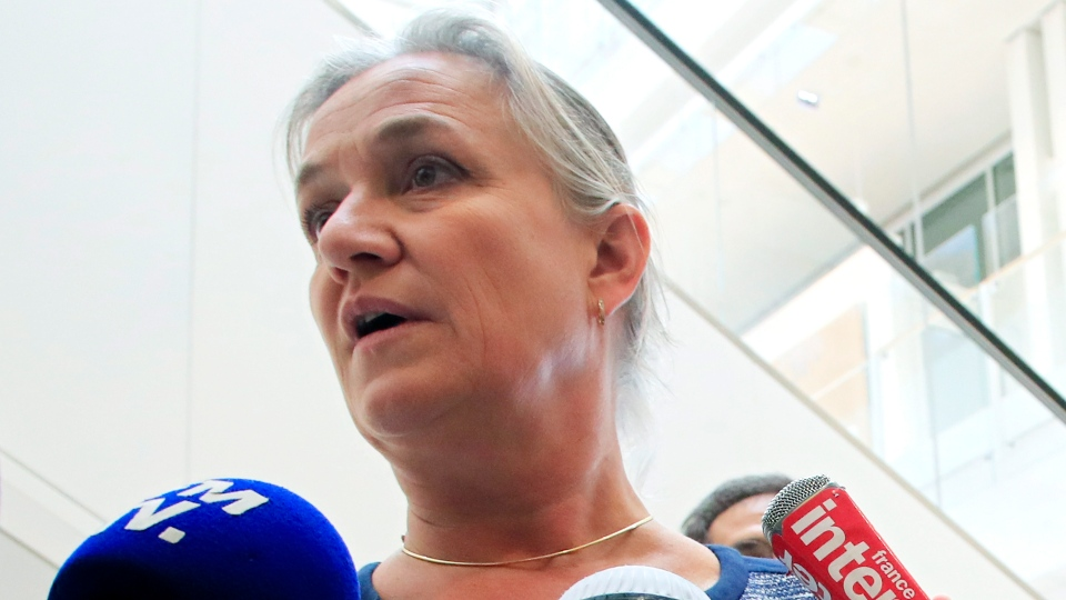 Dr. Irene Frachon, who discovered that the drug Mediator could have fatal side effect, speaks to reporters as she arrived at Paris courthouse Monday, Sept. 23, 2019. A massive trial with more than 4,000 plaintiffs is opening for French pharmaceutical giant Servier Laboratoires and France's medicines watchdog. (AP Photo/Michel Euler)