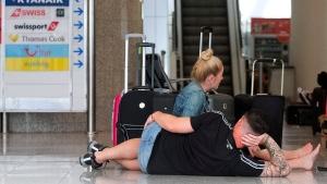 British passengers wait for news on cancelled Thomas Cook flights at Palma de Mallorca airport on Monday Sept. 23, 2019. (AP / Francisco Ubilla)