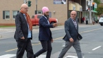 NDP leader Jagmeet Singh directs former NDP MP Yvon Godin, left, and Acadie-Bathurst candidate Daniel Theriault during a campaign stop in Miramichi, N.B. on Monday, Sept. 23, 2019. THE CANADIAN PRESS/Andrew Vaughan
