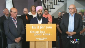 Former NDP MP Yvon Godin, federal NDP Leader Jagmeet Singh, and Daniel Theriault, the party's new candidate in the riding of Acadie-Bathurst, are seen in Bathurst, N.B., on Sept. 23, 2019.