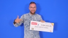 Ryan Dodd of London, Ont. picks up his winning $2.5-million cheque in Toronto on Monday, Sept. 23, 2019. (Source: OLG)