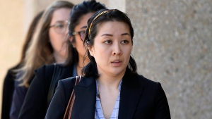 In this Sept. 12, 2019 file photo, Tiffany Li arrives at the courthouse in Redwood City, Calif. Opening arguments begin Monday, Sept. 23 in the trial of the San Francisco Bay Area real estate heiress who posted $35 million bail after being charged with the 2016 murder of her children's father. (AP Photo/Tony Avelar, File)