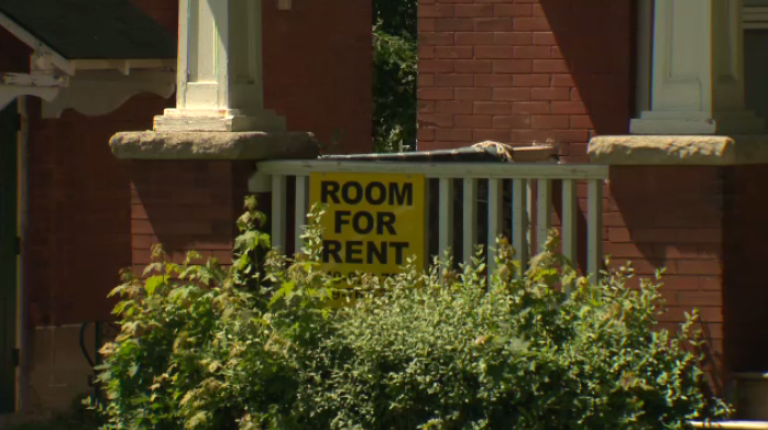A Room For Rent sign at a house