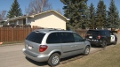 A CPS vehicle parked outside of a home on Atlanta Crescent S.E. in April 2018 during the police investigation into an incident that left an infant fatally injured