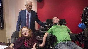 Nicole Gladu, left, and Jean Truchon, right, attend a news conference with lawyer Jean-Pierre Menard in Montreal, Thursday, September 12, 2019, where they gave their reaction to a Quebec judge overturning parts of provincial and federal laws on medically assisted dying. THE CANADIAN PRESS/Graham Hughes