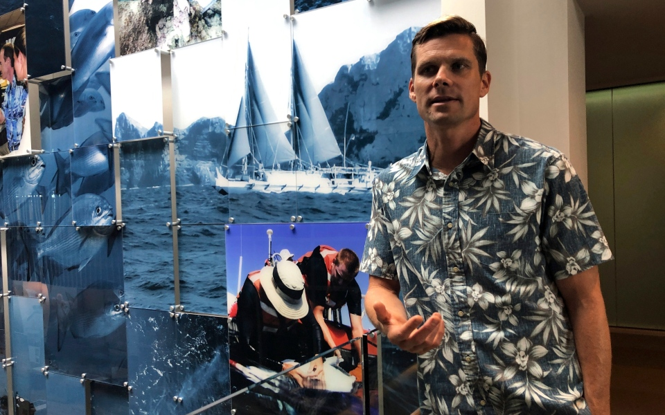 In this Sept. 16, 2019 photo, National Oceanic and Atmospheric Administration oceanographer Jamison Gove talks about coral bleaching at the NOAA regional office in Honolulu. U.S. federal researchers in Hawaii say ocean temperatures around the archipelago are on track to match or even surpass records set in 2015, the hottest year on record for the Pacific Ocean. They predict that heat will cause some of the worst coral bleaching and mortality the region has ever seen. (AP Photo/Caleb Jones)