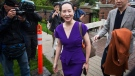 Huawei chief financial officer Meng Wanzhou, centre, who is out on bail and remains under partial house arrest after she was detained last year at the behest of American authorities, and her husband Liu Xiaozong, right, leave their home to attend a court hearing in Vancouver, on Monday, September 23, 2019. THE CANADIAN PRESS/Darryl Dyck