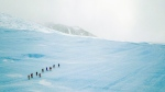 People hike along blue-ice during an excursion to the Drake Icefall in this 2018 image provided by Airbnb. (Christopher Michel / Airbnb)