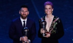Argentinian Barcelona player Lionel Messi poses with United States forward Megan Rapinoe after they received the Best FIFA Men's, Women's player award during the Best FIFA soccer awards ceremony, in Milan's La Scala theater, northern Italy, Monday, Sept. 23, 2019. (AP Photo/Antonio Calanni)